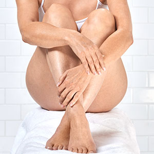 image of woman with smooth arm and leg skin